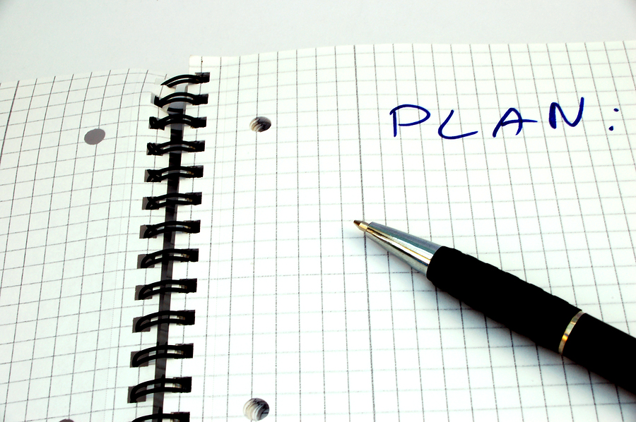 A sheet of paper with the word PLAN written on top