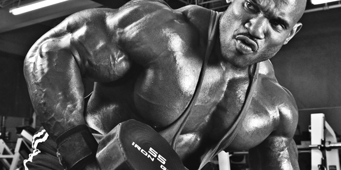 WATCH: Dumbbell Rows vs Barbell Rows for Back Development