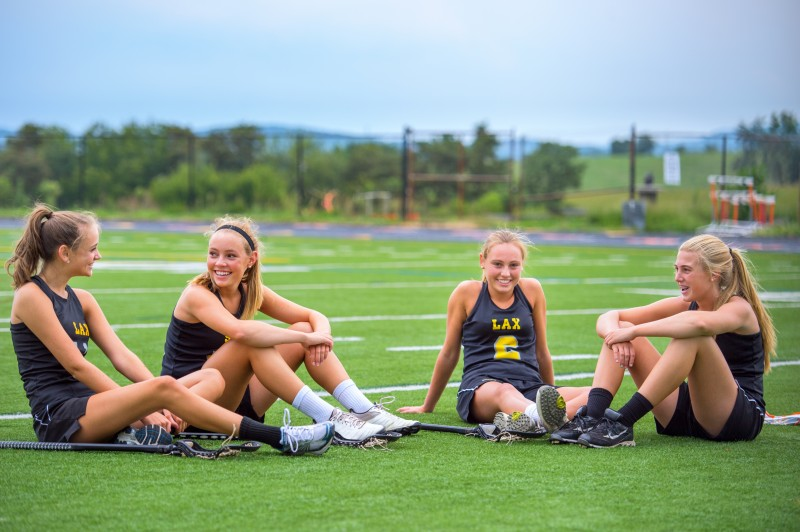 Four Girls Chat at Dusk After Lacrosse Practice