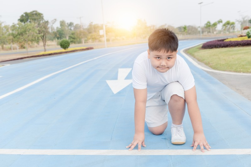fit and confident boy in starting position ready for running