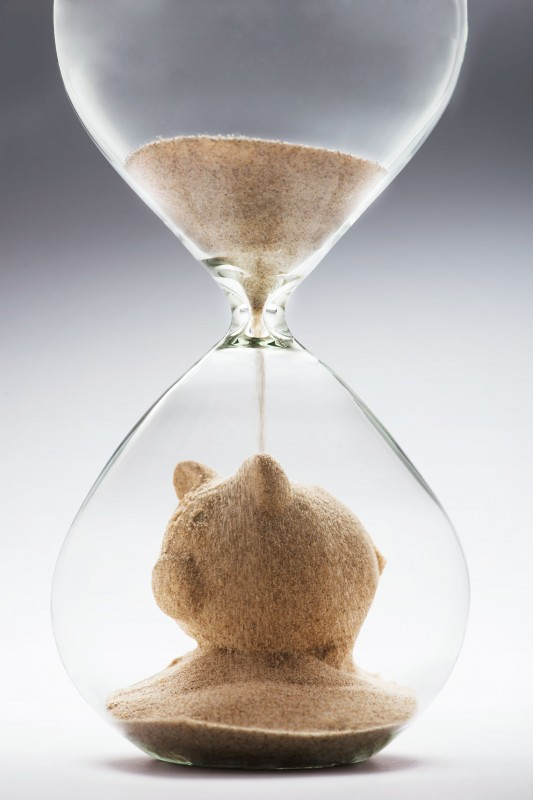 40614287 - savings concept with falling sand taking the shape of a piggy bank