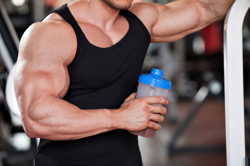 35086333 - young professional bodybuilder in the gym, drinking a protein shake