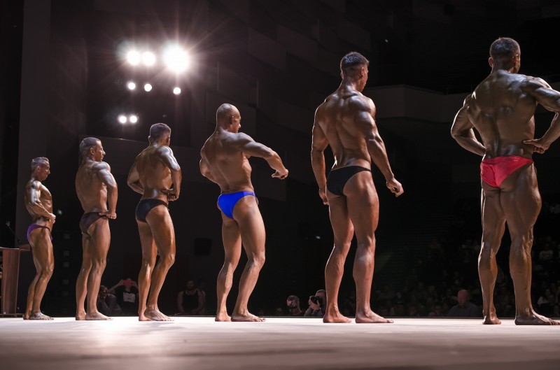 PENZA, RUSSIA - APRIL 29, 2017:Champion bodybuilders participating at the championship on stage at the open Cup of the cities of Russia on Fitness and Bodybuilding