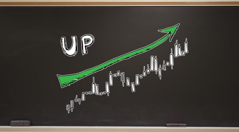 Market up trend chart on a blackboard