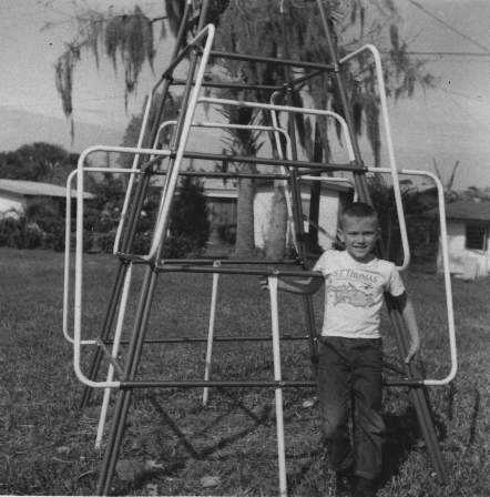 Boy_in_front_of_jungle_gym,_1967