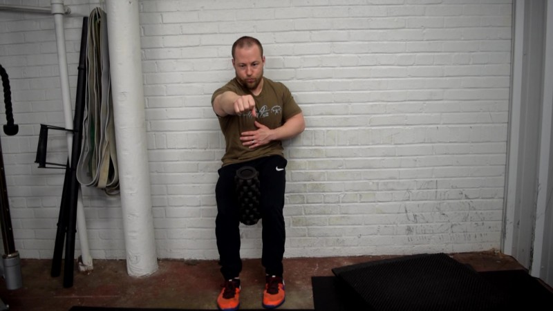 PRI-Wall-Supported-Squat-with-Right-Arm-Reach
