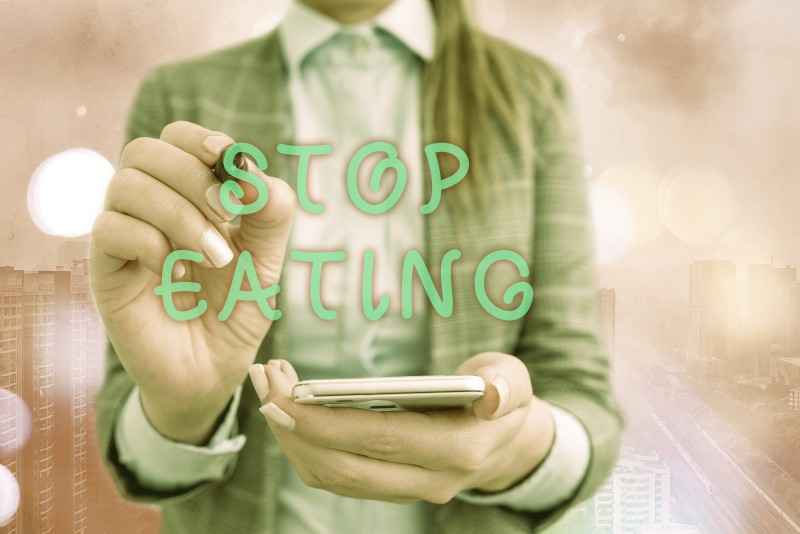 Text sign showing Stop Eating. Conceptual photo cease the activity of putting or taking food into the mouth.