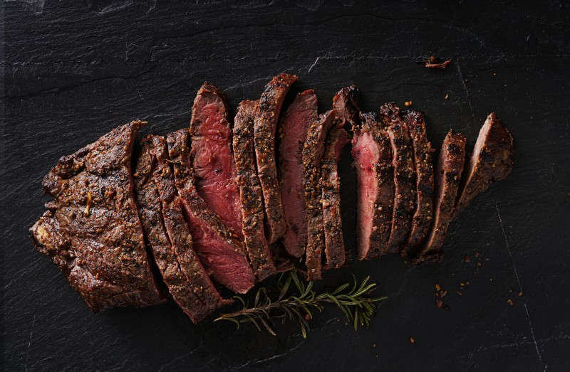 grilled flat iron steak shot in flat lay style from overhead